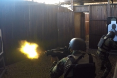 An Uraguayan competitor fires his weapon during a simulated hostage rescue mission July 22, 2017, during Fuerzas Comando in Cerrito, Paraguay. Teams must work together to take out all the enemy targets and rescue a hostage from captivity. Fuerzas Comando aims to improve partnerships among competing countries. (U.S. Army photo illustration by Pfc. Lauren Sam/Released) (This image was created by capturing a still frame from a video.)